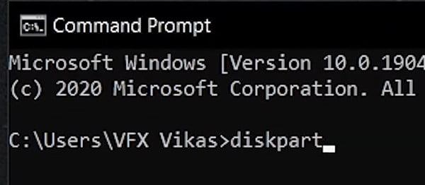 Type the command Diskpart